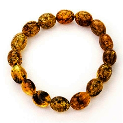 Beautifully shaped oval amber beads speckled with lots of inclusions.