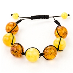 This fine macrame bracelet is made with honey and  custard amber. This bracelet includes black cord and a slide clasp to fit most wrists