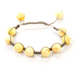 This fine macrame bracelet is made with 10 custard colored amber spheres. This bracelet includes grey cord and a slide clasp to fit most wrists.