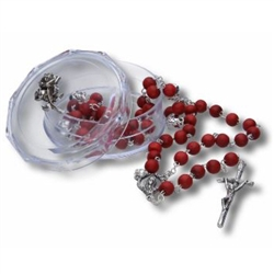 Hand made in Poland this traditional rose colored wooden rosary features a center medallion of John Paul II.