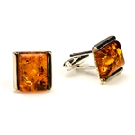 "Squares of cognac colored amber set in sterling silver.  Approx .5"" square."
