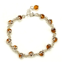 "Darling trail of sterling silver and amber ladybugs.  Adjustable from 7"" to 8.5"""