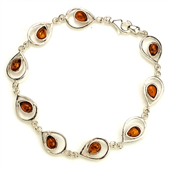 "9 tear shaped amber beads each set in a sparkling sterling silver frame. 8"" - 20cm long."