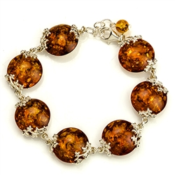"7 spheres of amber each set with sparkling sterling. 7"" to 8"" adjustable."