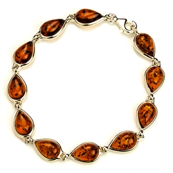 "11 tear shaped amber beads each set in a sterling silver frame. 7"" - 18cm long."