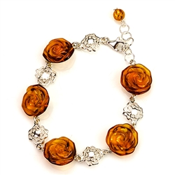 "5 hand carved amber roses each set on a filigree sterling silver circle. Adjustable from 7"" - 8"" long."