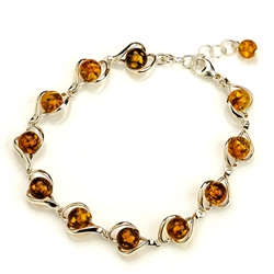 "7 round amber beads each set in a sparkling sterling silver frame. 7"" to 8"" adjustable."