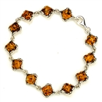 "12 square amber beads each set in a sterling silver frame. 7"" - 18cm long."