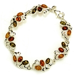 "Three shades of amber set in silver in this lovely bracelet 7.5"" long."