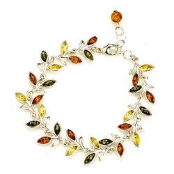 Three colors of amber set in silver shaped to form a trail of leaves in this lovely bracelet 7.5: long and adjustable to shorten.