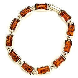 "11 rectangular shaped amber beads each set in a sterling silver frame. 7.25"" long."