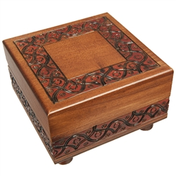 Looks like a beautifully finished and detailed wooden box from Poland (which it is), but there's more than meets the eye! This box won't open if you don't know the trick. Rotating feet unlock the box.  Interior has a red felt lined bottom.