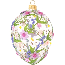 Artfully hand-crafted in Poland, this gorgeous clear glass egg is embellished with fabric, beads, and glitter in a pink and purple flower motif. Elegant and colorful, this glass egg ornament with pink and purple flowers will make a stunning keepsake for