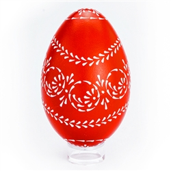 This beautifully designed egg is dyed one color (red) then white wax is melted and applied using a drop pull technique to form a design which is left on the surface. The egg is then emptied through a hole at the top and bottom. Stand sold separately. Hand