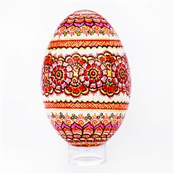 This beautifully designed goose egg is hand painted by master folk artist Krystyna Szkilnik from Opole, Poland. The painting is done in the traditional style from Opole. Eggs are blown and can last for generations. Goose eggs are stronger and larger than