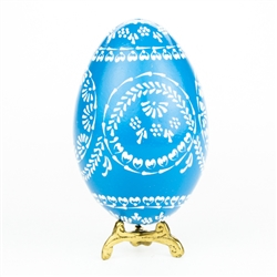 This beautifully designed egg is dyed one color then white wax is melted and applied to form an intricate design which is left on the surface. The egg is emptied. Stand not included.
