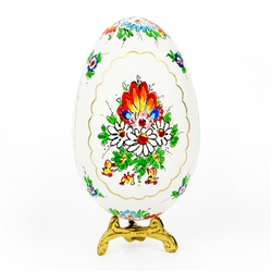 This beautifully designed goose egg is hand painted by master folk artist Alina Wypchlo from Opole, Poland. Her colors are strong and bright. Look carefully and you will find humorous folk elements of nature incorporated into her designs (i.e. a cricket