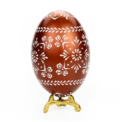 This beautifully designed egg is dyed one color (dark green) then white wax is melted and applied to form an intricate design which is left on the surface. The egg is emptied. Stand not included.