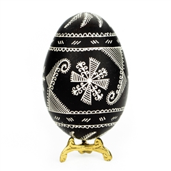 This beautifully designed goose egg is colored using the drop pull method and comes from the Bialystok region of northeast Poland. Eggs are blown and can last for generations. Goose eggs are stronger and larger than chicken eggs which makes them especiall