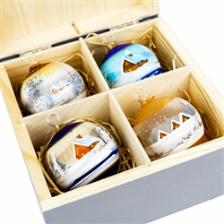 "Hand painted glass ornaments featuring Polish country scenes in a deluxe painted wooden box. Hand made so no two ornaments or boxes are exactly the same. Ornaments are approx 2.25"" in diameter."