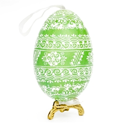 This beautifully designed egg is dyed one color, then white wax is melted and applied to form an intricate design which is left on the surfce. The egg is emptied and strung with ribbon for hanging or you can remove the ribbon.  This is the work of master