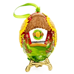 This beautifully designed chicken egg is hand painted and decorated. The figures are made from dried salt that is applied to the egg, formed, dried and finally painted. A little work of art and ready to hang.  Stand sold separately.