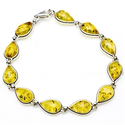 "11 tear shaped amber beads each set in a sterling silver frame. 7.5"" - 19cm long."