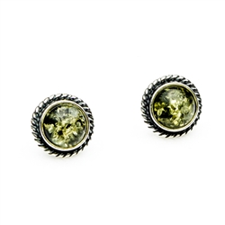 Charming sterling silver stud earrings with green amber center.  Size approx 1cm diameter.