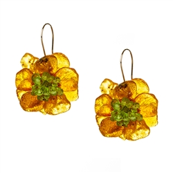 Bozena Przytocka is a designer of artistic amber jewelry based in Gdansk, Poland. Here is a beautiful example of her ability to blend amber and peridot.