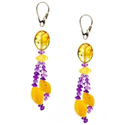 Bozena Przytocka is a designer of artistic amber jewelry based in Gdansk, Poland. Here is a beautiful example of her ability to blend amber and amethyst to create a stunning set of earrings.