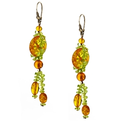 Bozena Przytocka is a designer of artistic amber jewelry based in Gdansk, Poland. Here is a beautiful example of her ability to blend amber and peridot to create a stunning set of earrings.