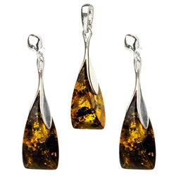 "Artistically shaped amber and silver earrings and pendant set.  Approx 1.5"" long."