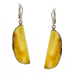 Beautiful slices of natural Baltic amber encased in sterling silver frames.