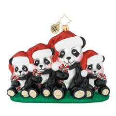 Smartly dressed in their Christmas best, these cuddly pandas hold on to their family photo tradition. Picture perfect!