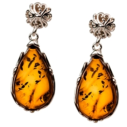 "Gorgeous Baltic Amber oval stud earrings surrounded with a ring of Sterling Silver filigree work. Approx .75"" long x .5"" wide."