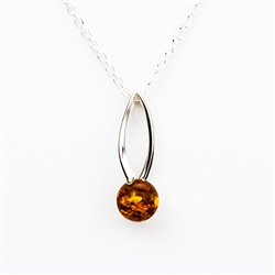 "Artistic sterling silver pendant and adjustable length chain (18"" long max.) surrounding a honey amber sphere."