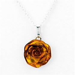 "Beautiful amber rose pendant on an adjustable length silver chain (18"" long max.)  Amber rose is approx .5"" diameter. x .25"" wide. Sterling silver back."