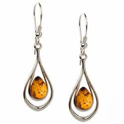 "Honey amber ovals suspended in two silver rings.  Size approx 1.75"" x .5""."