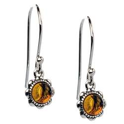 "Delicate circles of Baltic amber suspended from sterling silver French hooks. Size approx .75"" x .25""."