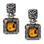 "Gorgeous Baltic Amber square stud earrings surrounded with a ring of antique style sterling silver. Size approx .75 x .4""."