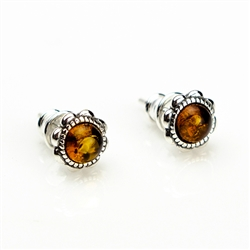 "Baltic Amber stud earrings with sterling silver detail.  Size approx .3"" diameter."
