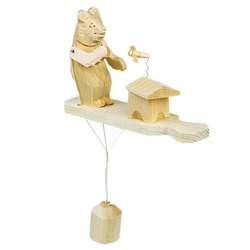 Wooden spin toy from Russia that will bring smiles to all who try it! This bear is preparing for a tasty treat of honey!  A perfect example of an old fashioned action toy. Hand made traditionally by parents and grandparents for their children. a wonderful