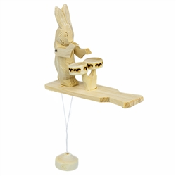 Most of the Russian action toys feature bears in action. Here's an Old World wooden toy featuring Brer Rabbit. As the pendulum below this Russian action toy swings, the carved plays the drums in the most delightful fashion. It makes a nice addition to a