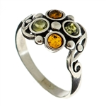 Petite artistic four stone amber and silver ring.
