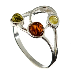 Petite artistic three stone amber ring.