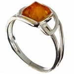 Petite size honey amber set in sterling silver.