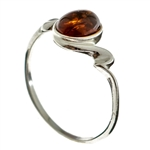 Petite size honey oval amber set in sterling silver.