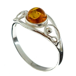 Petite size honey round amber set in sterling silver.