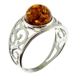 Petite size round honey amber set in sterling silver.