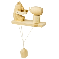 Wooden spin toy from Russia that will bring smiles to all who try it! This bear is a two fisted drinker with a cup in each hand! A perfect example of an old fashioned action toy.